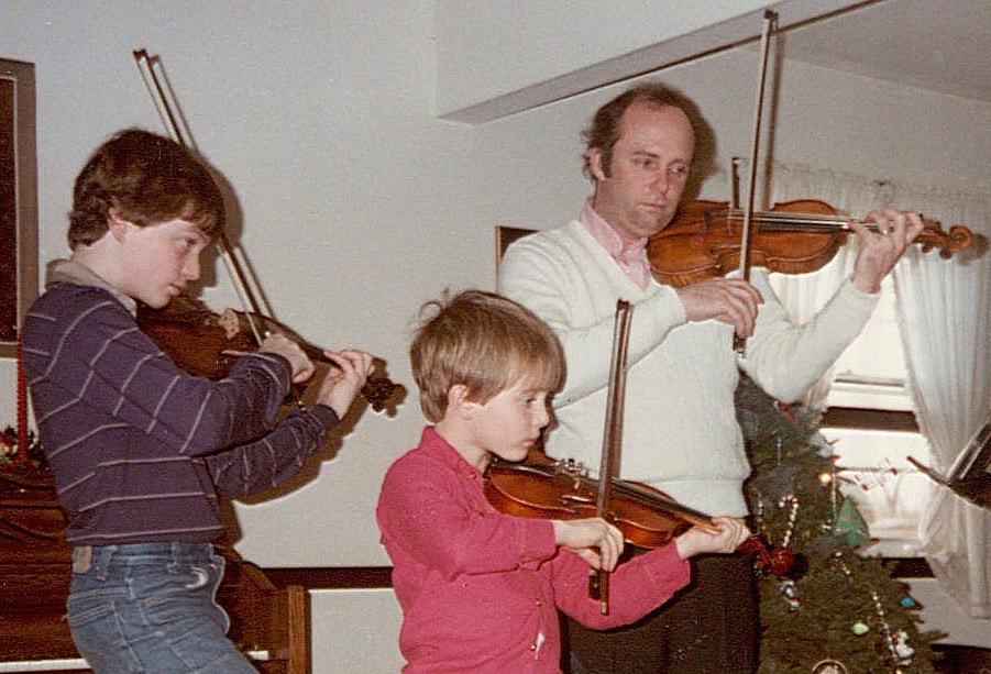 Garrett Fischbach as a child playing violin with family